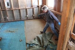 Here's The Hammer removing soggy, yucky carpet and pad - blah!